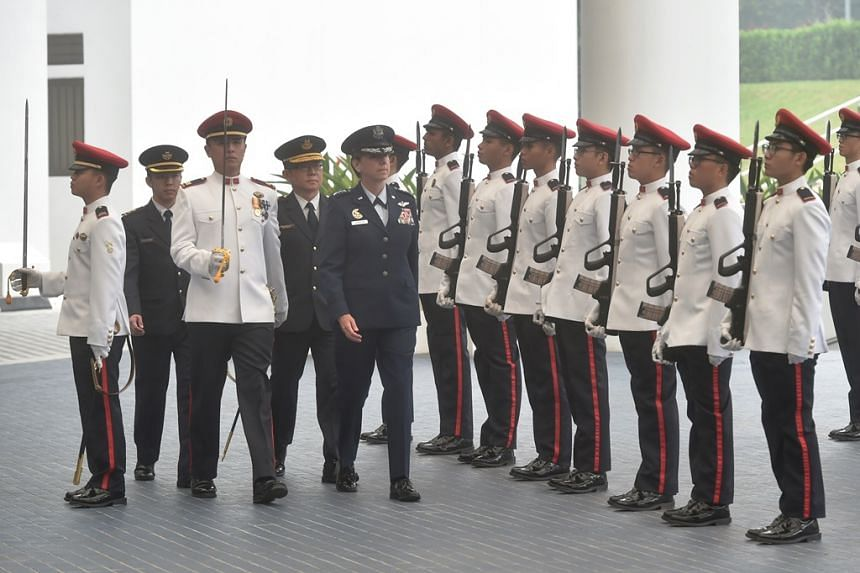 The Commander of the United States Pacific Air Forces General Lori J. Robinson inspecting the Guard of Honour at the Ministry of Defence.