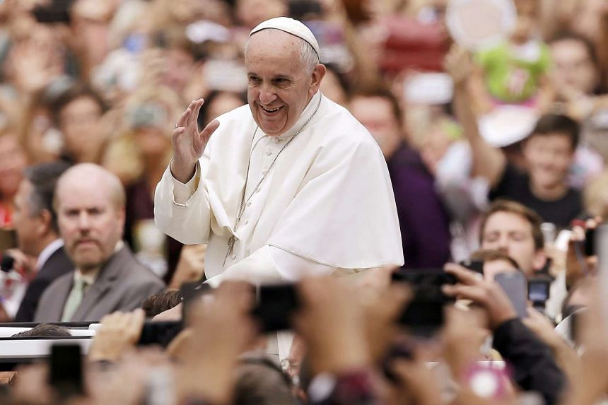 Pope Francis waving from the popemobile during a parade in Philadelphia on Sept 27, 2015.