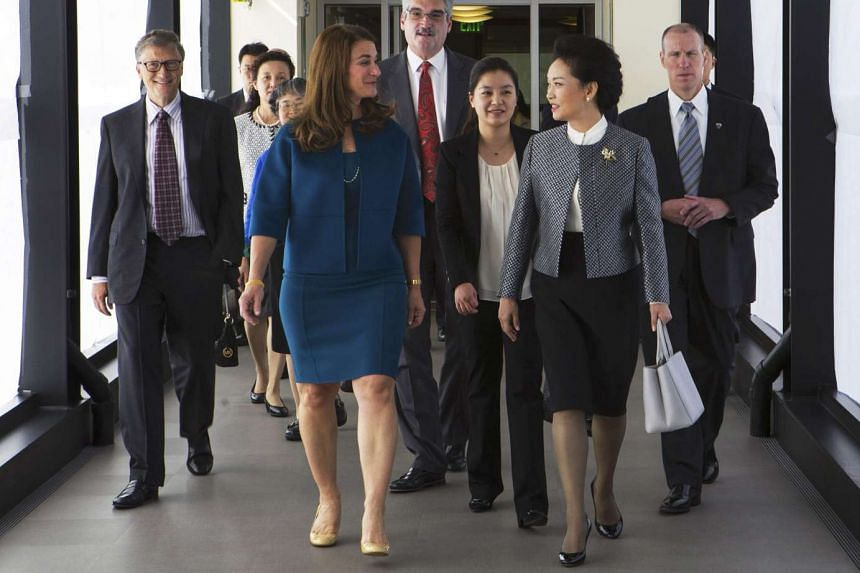 Ms Peng (right) in a power suit at the Fred Hutchinson Cancer Research Center in Seattle, Washington, with Mrs Melinda Gates, wife of Microsoft co-founder Bill Gates. The pairing of a collarless jacket with her white shirt highlights the mandarin collar d