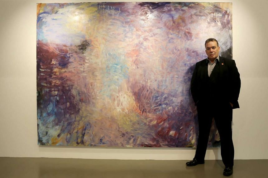 Painter Frank Holliday and his oil on canvas titled Trailing A Violet Haze (2013), which is shown in an exhibition here.