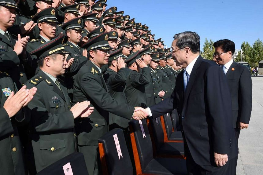 """Mr Yu Zhengsheng, China's fourth-most-senior leader, meeting military representatives in Kashgar, southern Xinjiang, last Saturday. Mr Yu said southern Xinjiang was the """"main battleground in the anti-separatist struggle"""", and urged the soldiers there"""