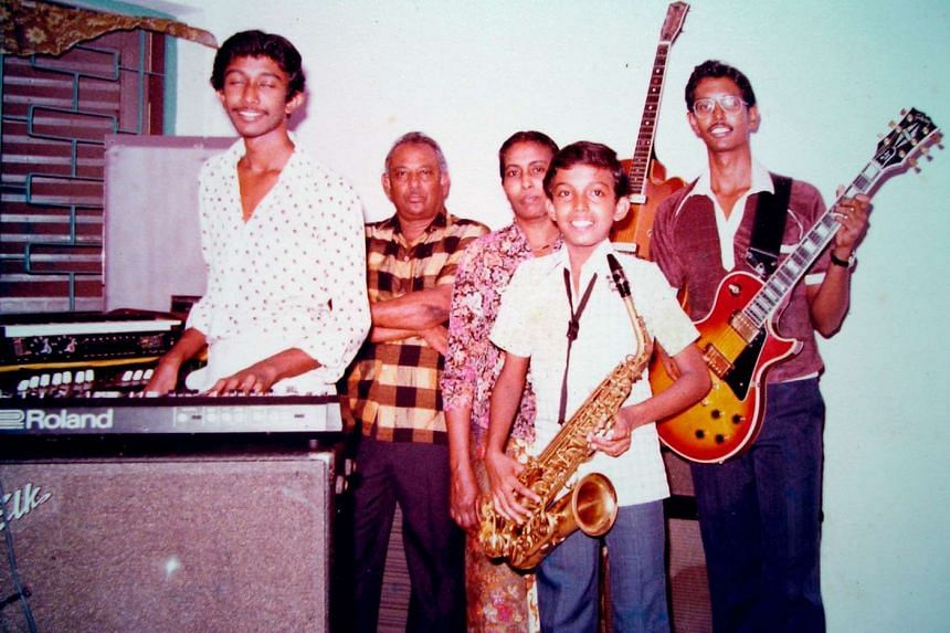 Mohamed Raffee (above right) with his family in a 1977 photograph, (from left) younger brother Mohamed Bashir, father Syed Yakob, mother Hamidah Sulaiman and youngest brother Mohamed Noor