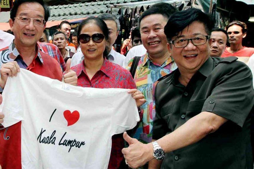 Chinese ambassador to Malaysia, Dr Huang Huikang (left), and his wife (centre) visiting Petaling Street, Kuala Lumpur's Chinatown, last Friday. Accompanying them was Hawkers and Petty Traders Association president Ang Say Tee (right).