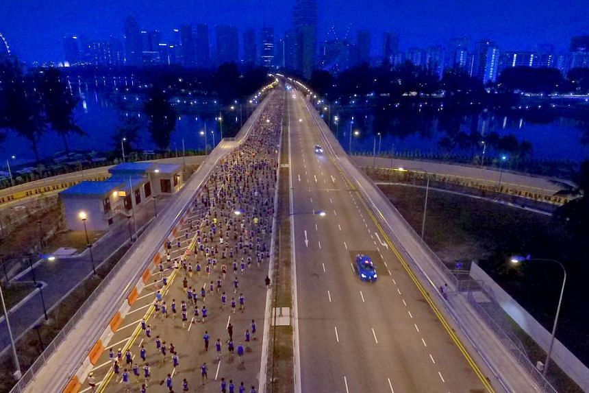 Runners taking part in the 10km race in the ST Run at the Hub getting on their way after they were flagged off near the Singapore Sports Hub around 6.30am yesterday.
