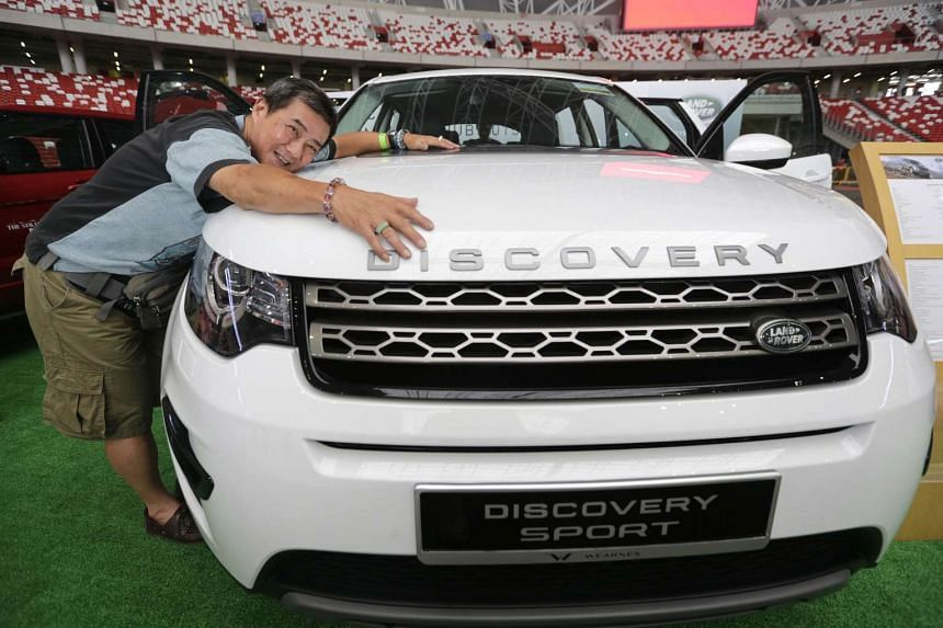 Mr Mike Lee with a Land Rover Discovery Sport. He won the vehicle worth $165,000 (without COE) in a lucky draw at The Straits Times Run at the Hub yesterday. He was one of 2,000 shortlisted from a batch of 65,000 eligible entries. Overwhelmed by shoc
