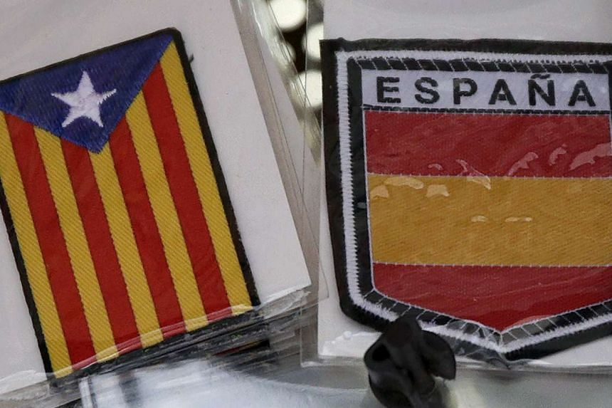 "Souvenirs of a Spanish flag and an ""Estelada"" flag."