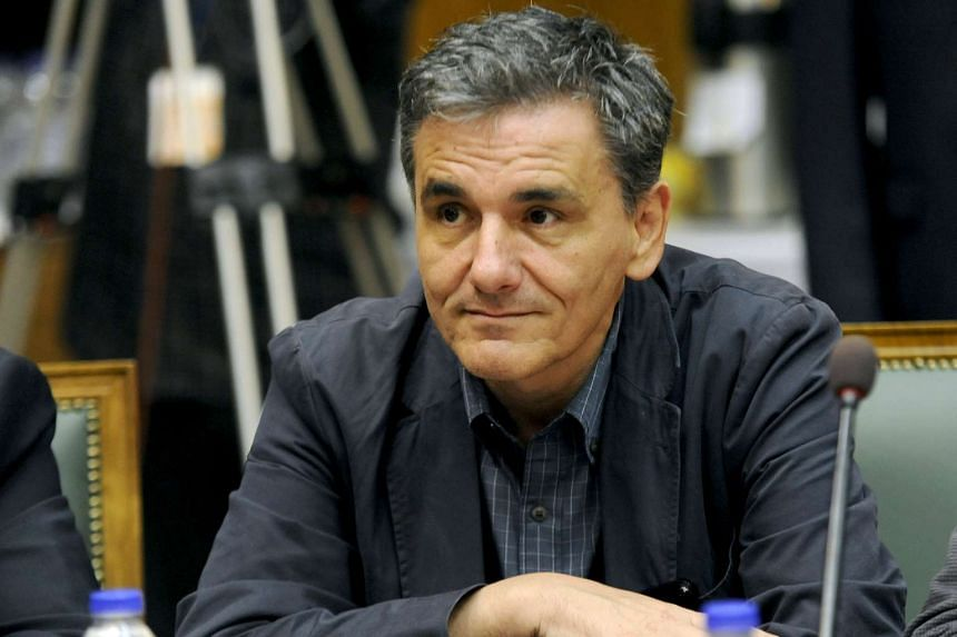 Greek Finance Minister Euclid Tsakalotos attends the first meeting of the new cabinet in the parliament building in Athens, Greece Sept 25, 2015.