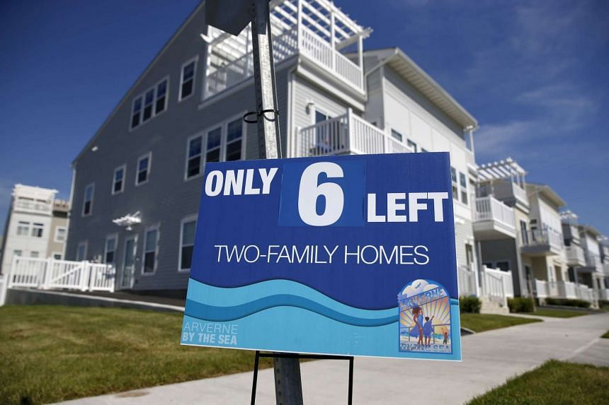 An advertisement for two-family homes is seen outside an oceanside community in the Rockaway area of the Queens borough of New York, in this file photograph taken Sept 16, 2015.