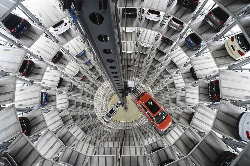 A file picture of a VW Golf VII (right) and a VW Passat being loaded at the plant of German carmaker Volkswagen in Wolfsburg, Germany.