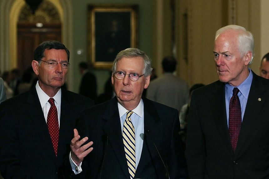Senate Majority Leader Mitch McConnell (center) speaks to the media while flanked by Sen. John Barrasso (left) and Sen John Cornyn, during a news conference after the Republican policy luncheon on Capitol Hill Sept 22, 2015 in Washington, DC.