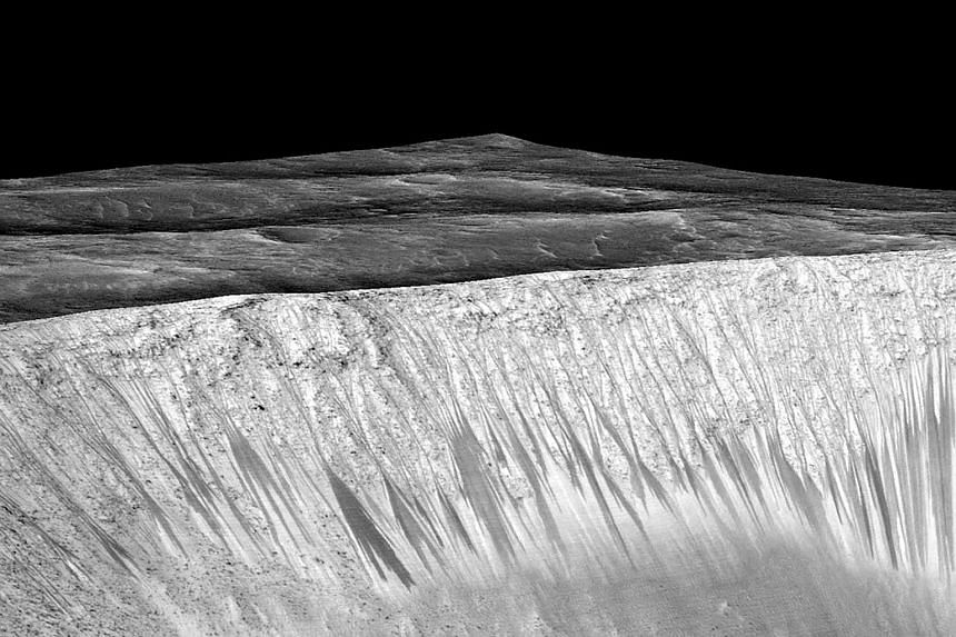 Dark narrow streaks called recurring slope lineae emanating out of the walls of Garni crater on Mars are seen in an image produced by Nasa, Jet Propulsion Laboratory (JPL) and the University of Arizona.
