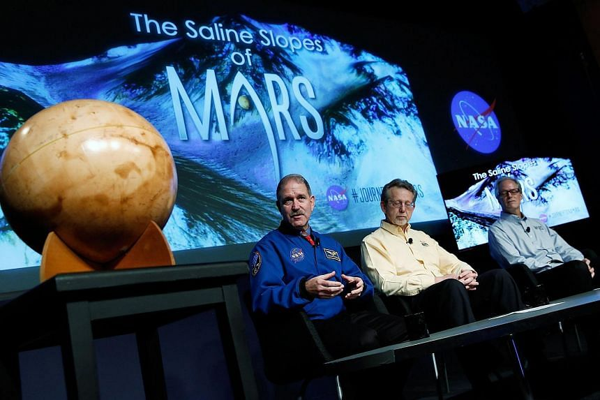 "Mr John Grunsfeld, associate administrator at Nasa's Science Mission Directorate, speaking during a press conference where Nasa announced new findings that provide the ""strongest evidence yet"" of salty liquid water currently existing on Mars. With hi"