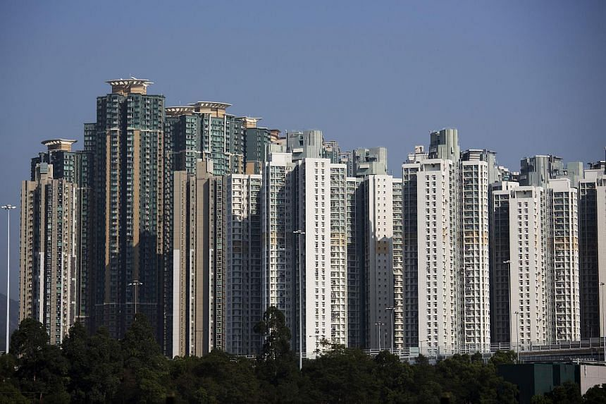 Residential buildings stand in the Lai Chi Kok district of Hong Kong, China.