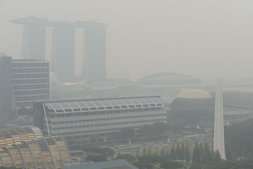The Singapore skyline shrouded in haze.