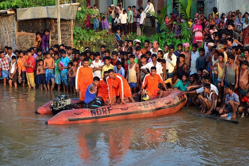 National Disaster Response Force (NDRF) personnel searching for the victims at the site where a riverboat capsized in Kolohi River, Assam, India, on Sept 28, 2015.