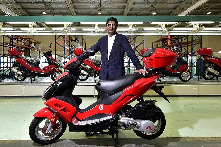 Alife Air Automobiles' president and CEO Devan Nair with the A bike, which comes in 125cc and 150cc variants and in four designs. The scooters are designed and assembled in Singapore. Behind Mr Nair is the assembly line in Bukit Batok.