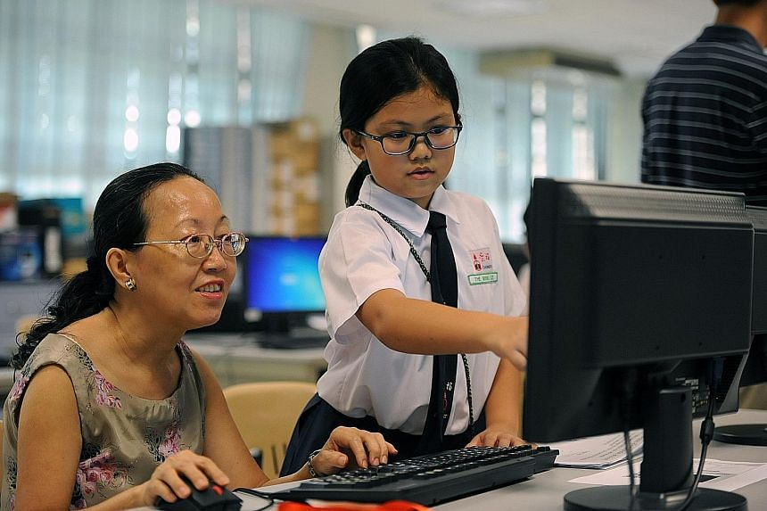 Madam Angeline Leong, 62, taking a free basic computer skills course at Chongfu School under the Council for Third Age's Intergenerational Learning Programme, where senior citizens get to interact with the younger generation as they learn how to ta