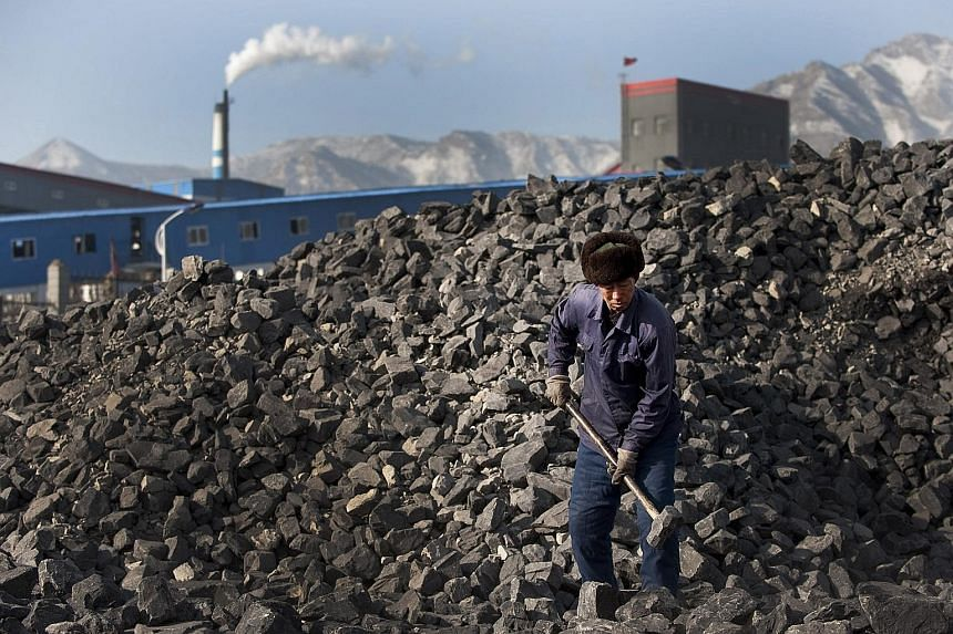 A coal worker in Shanxi province in China. Profits in coal mining plunged 64.9 per cent in the first eight months of this year from the same period last year, while oil and gas profits tumbled 67.3 per cent.