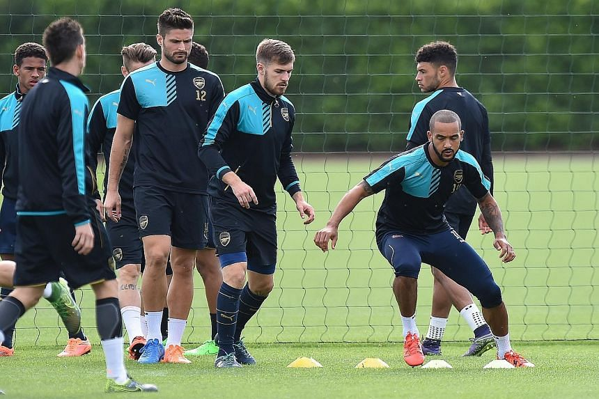 Theo Walcott (far right) is confident he can deliver the goods if he is deployed as the sole striker against Olympiakos.