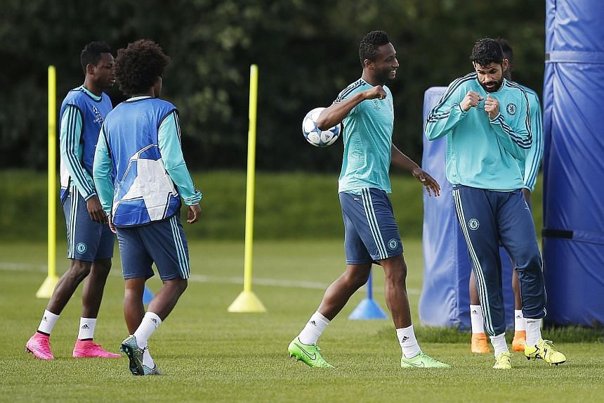 Chelsea's Diego Costa (right) and John Obi Mikel during training. The Spaniard's ban does not cover Europe so he will be raring to play tonight.