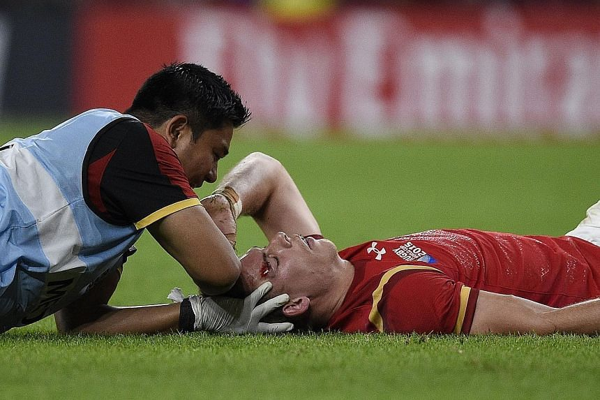 Wales' full-back Liam Williams receiving medical attention after he is kicked in the head by Tom Wood. The England flanker has apologised and says his action was not on purpose.