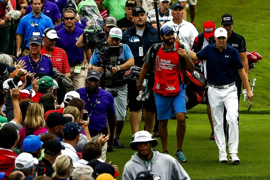Jordan Spieth, with a crowd following him to the 18th green, nails a sensational season with his Tour Championship win.