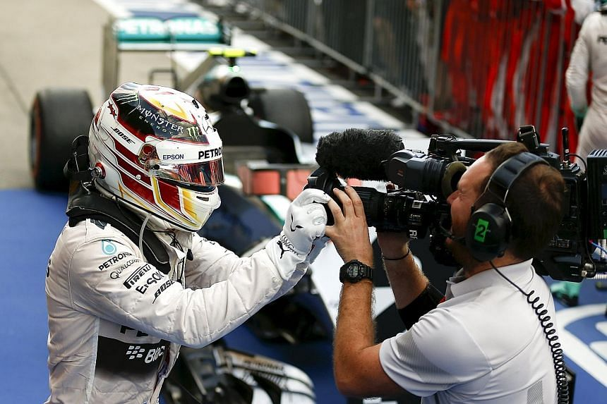 Lewis Hamilton gestures at a camera after winning at Suzuka in a race where TV viewers worldwide hardly ever get to keep track of the Mercedes cars in action.