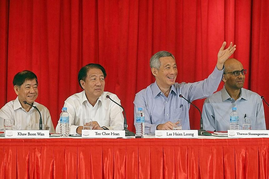 PM Lee Hsien Loong taking questions from reporters at the press conference in the Istana yesterday. With him are (from left) incoming Transport Minister Khaw Boon Wan, who will tie urban planning and infrastructure together, DPM Teo Chee Hean, who wi
