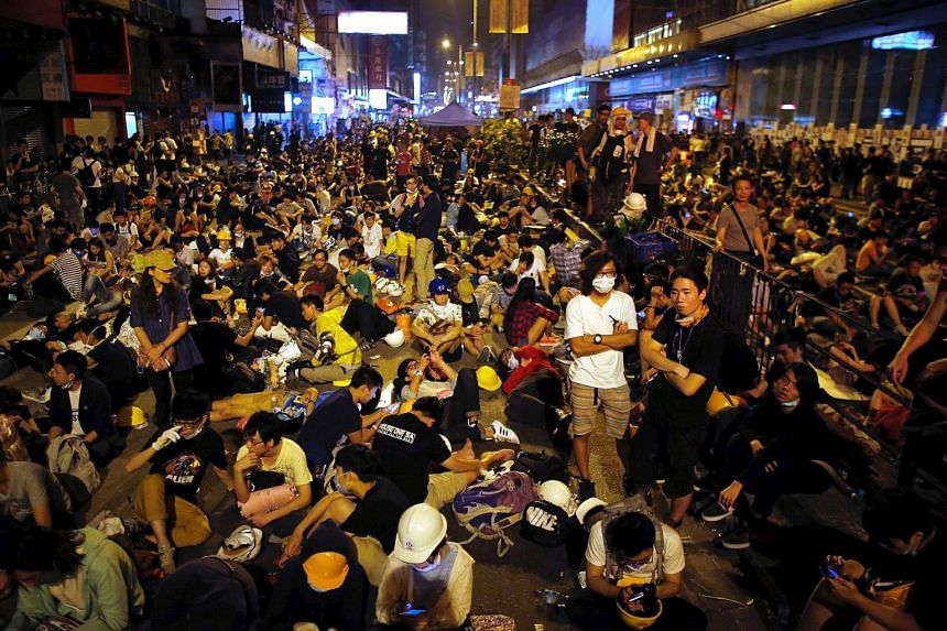Mong Kok last year was where the most violent clashes took place during the pro-democracy sit-in. (Top) Protesters occupying a street to block traffic on Oct 20 last year and (above) the same location on Sept 16. Occupy Central co-founder Benny Tai (
