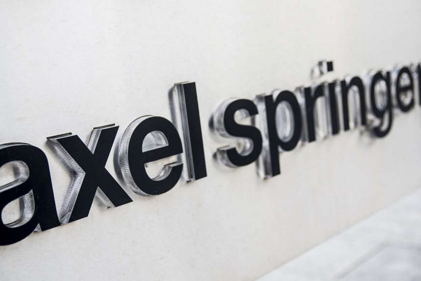 The logo of the German publisher Axel Springer is seen outside its headquarters in Berlin, Germany, which has agreed to take over Business Insider Inc. in a US$343 million (S$489.47 million) deal.