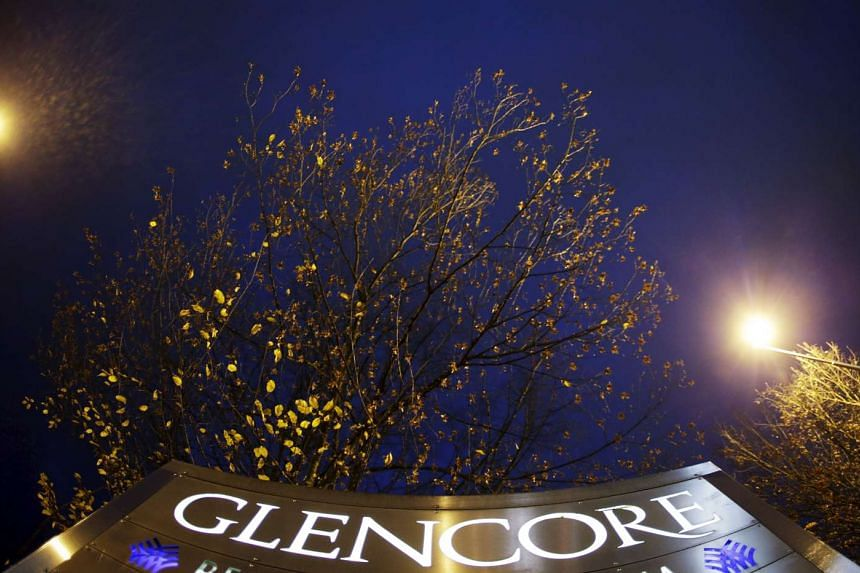 Glencore's logo is pictured in front of the company's headquarters in the Swiss town of Baar.
