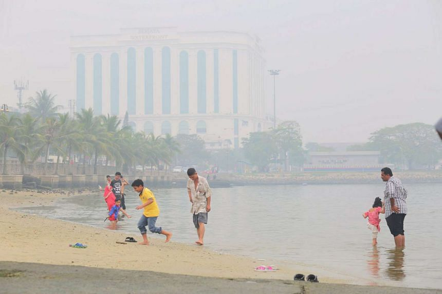 People having a dip by the sea at Stulang in Johor Baru during the holiday season on Sept 24, 2015, despite the haze.