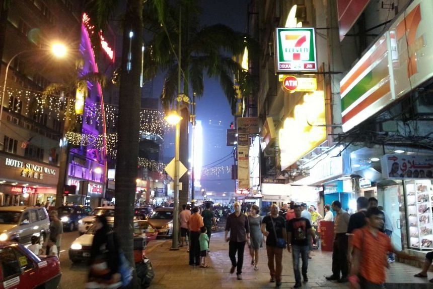 Shoppers walking along the streets in Jalan Bukit Bintang, a shopping district in Kuala Lumpur.