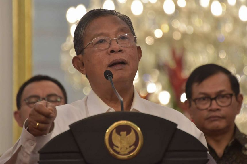 Indonesia's Coordinating Minister for Economic Affairs Darmin Nasution delivers a statement on the economy at the presidential palace in Jakarta on Sept 9, 2015.