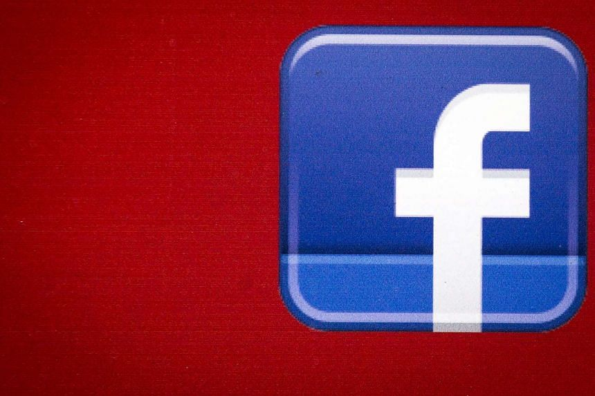 A Facebook logo is displayed on the side of a tour bus in New York's financial district,