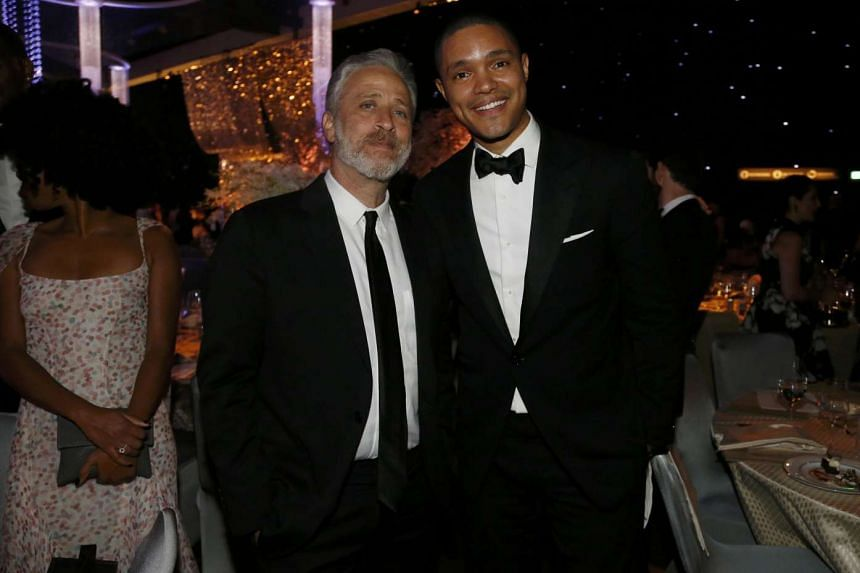Television personality Jon Stewart (left) poses with his successor on The Daily Show Trevor Noah at the 67th Annual Primetime Emmy Awards Governors Ball in Los Angeles, California Sept 20.