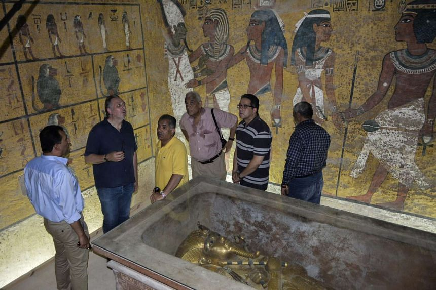 British Egyptologist Nicholas Reeves (second from left) and Egyptian Minister of Antiquities Mamdouh Eldamaty (third from left) stand inside the King Tutankhamun burial chamber in the Valley of the Kings, Luxor, Egypt on Monday.