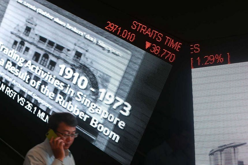 The Straits Times Index shown in SGX Centre.