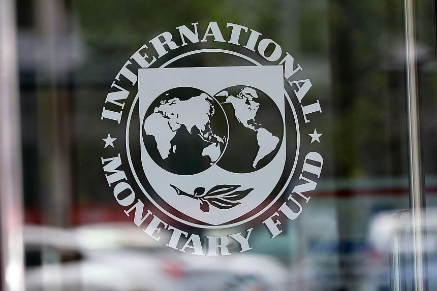 The seal of the International Monetary Fund at the headquarters building in Washington, DC.