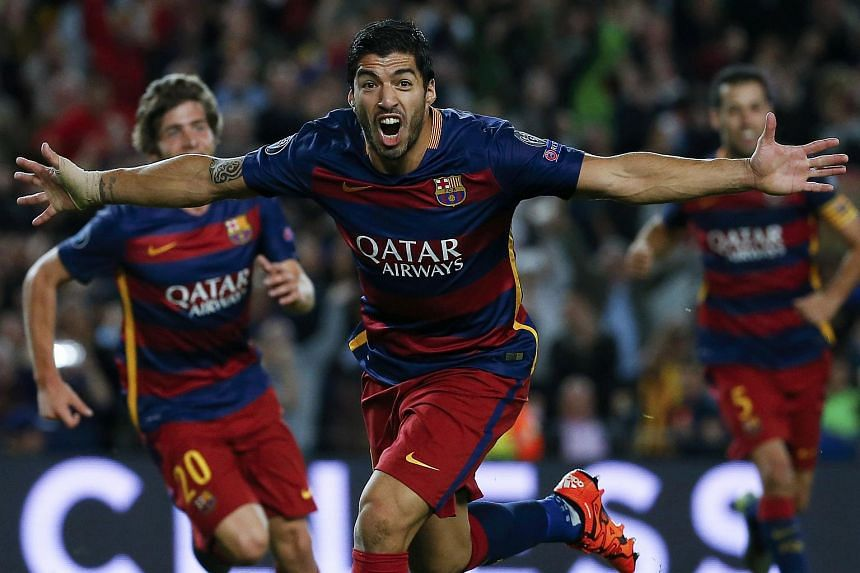 Barcelona's Luis Suarez celebrates after scoring a goal against Bayer Leverkusen during their Champions League group E soccer match at Camp Nou stadium in Barcelona, Spain, on Sept 29, 2015.