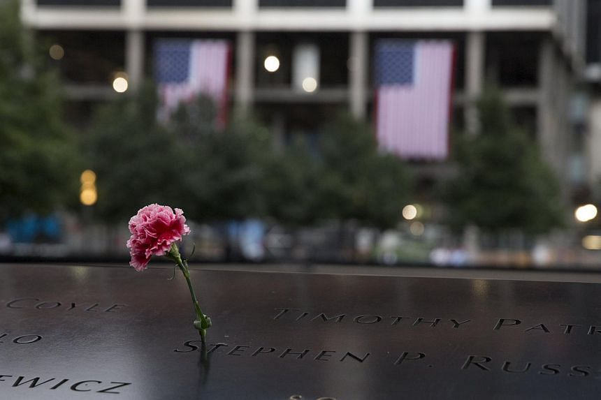 A flower is seen placed during a ceremony marking the 14th anniversary of the 9/11 attacks, at the National September 11 Memorial and Museum on Sept 11, 2015.
