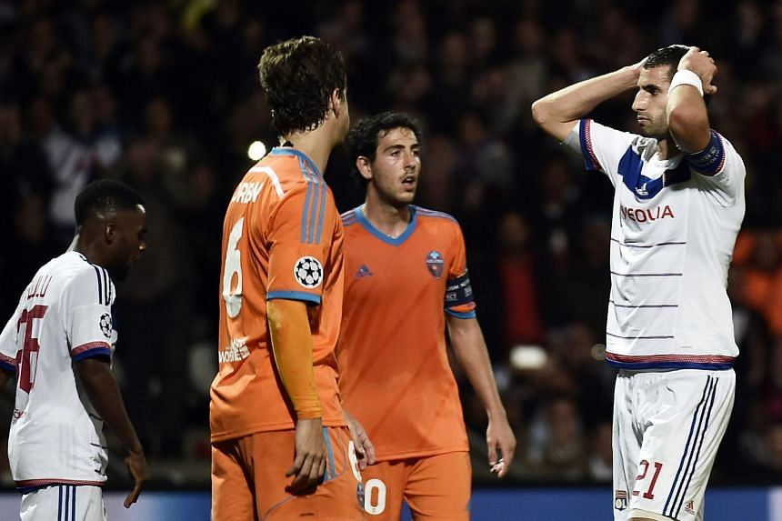 Lyon's French midfielder Maxime Gonalons (right) reacts at the end the Champions League group H football match between Lyon and Valencia on Sept 29, 2015 at the Gerland stadium in Lyon, central-eastern France.