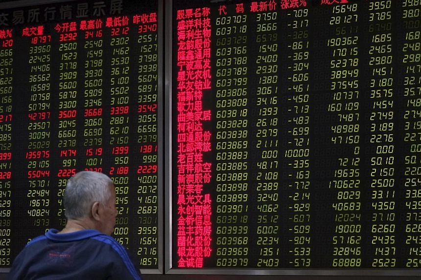 An investor sitting in front of an electronic board showing stock information in Beijing, China, on Sept 25, 2015.