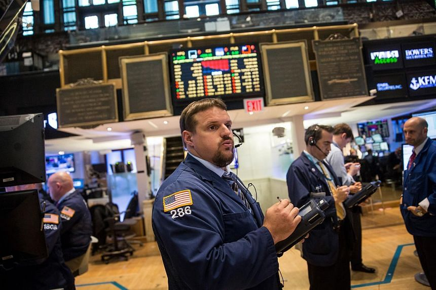 A trader working on the floor of the New York Stock Exchange on Sept 28, 2015, in New York City.