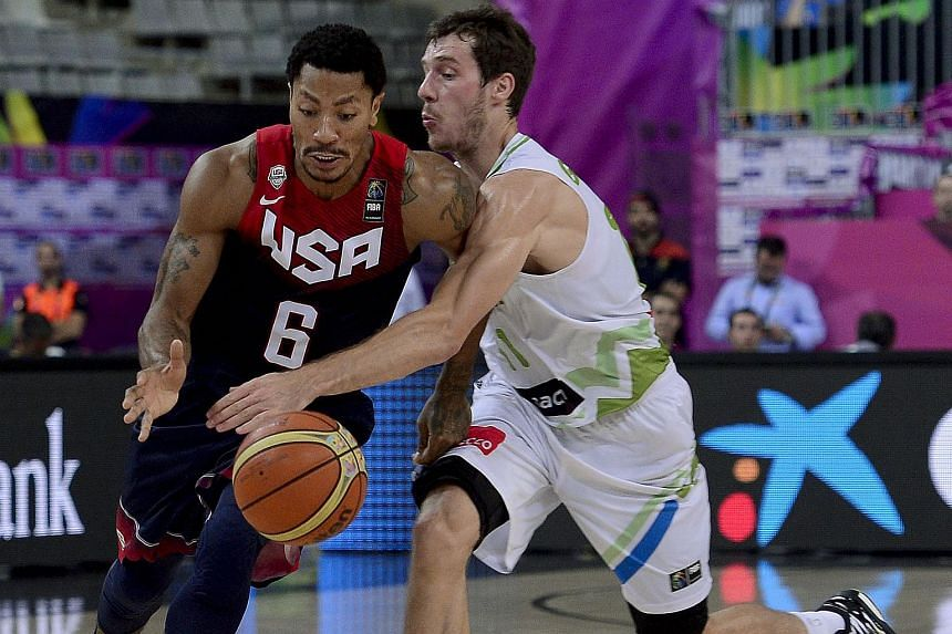 US guard Derrick Rose (left) vying with Slovenia's guard Klemen Prepelic during the 2014 FIBA World basketball championships quarter-final match.