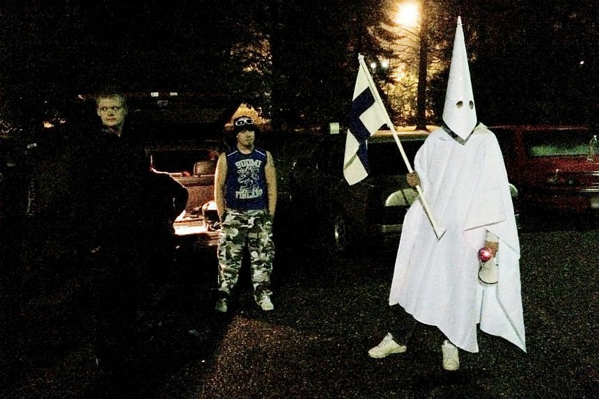 Demonstrators taking part in a protest against asylum seekers in the Hennala district in Lahti on  Sept 24, 2015.