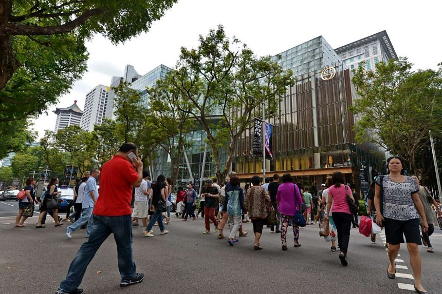 People crossing the road between Ngee Ann City and Paragon in Orchard Road on Sept 25, 2014.