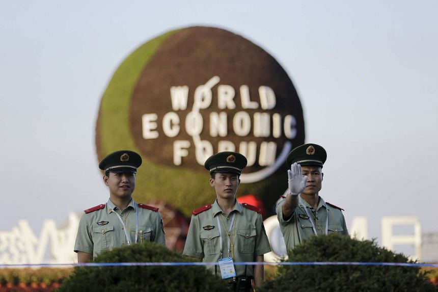 Paramilitary police officers standing guard outside the venue of the World Economic Forum meeting (WEF) in Dalian, China on Sept 8, 2015.