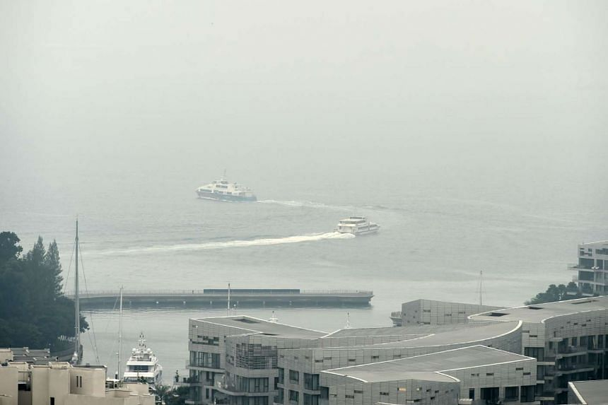 Ferries leaving the harbour front terminal as they head to Batam across the haze shrouded strait of Singapore on Sept 10, 2015.