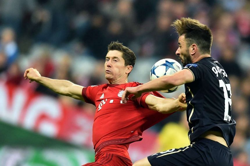 Munich's Robert Lewandowski (left) and Goncalo Santos of Dinamo Zagreb in action during the UEFA Champions League group F soccer match between Bayern Munich and Dinamo Zagreb at Allianz Arena in Munich, Germany on Sept 29, 2015.